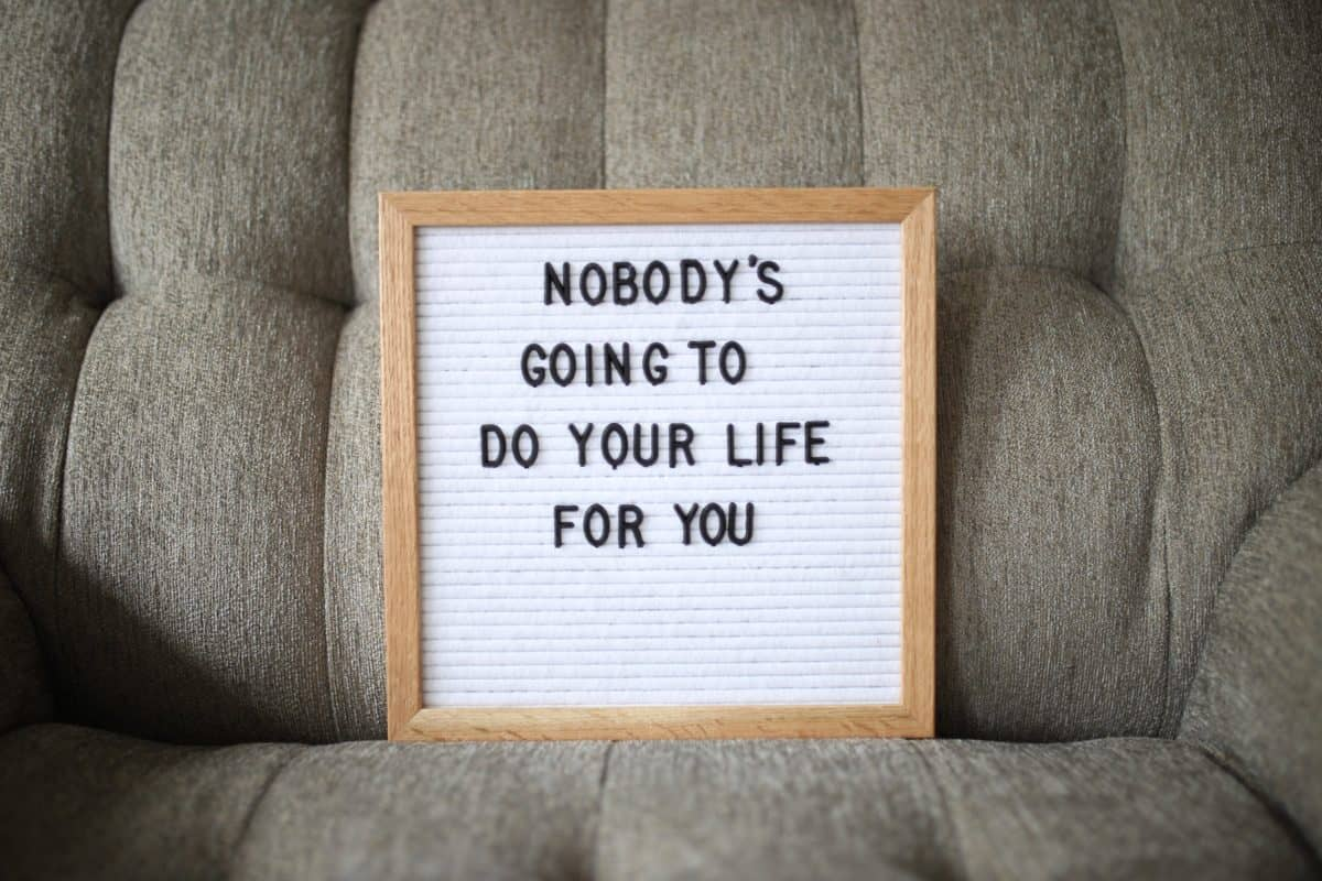 Whiteboard with the phrase Nobody's Going to do Your Life for You