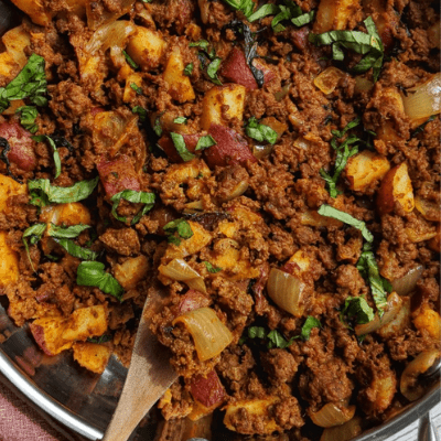 Whole30 Thai Red Curry Beef Bowl ingredients in a skillet