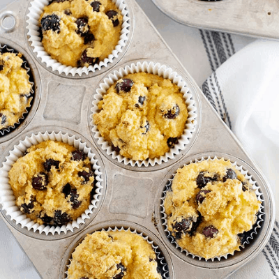 Whole30 Blueberry Coconut Flour Muffins in muffin tin
